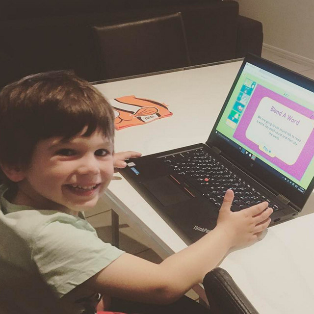 Child using Reading Eggs on a laptop